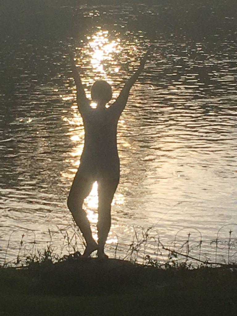 Woman doing yoga along the Fox River